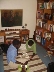 My oldest girls reading in the library at home in Masaka, Uganda. (The painting now hangs in my USD office.)